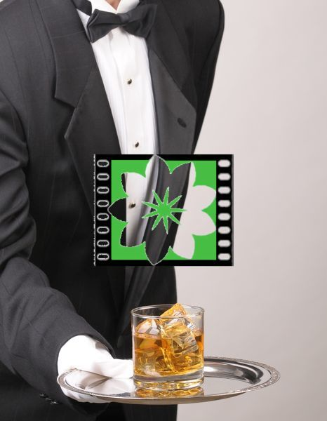 Waiter in tuxedo Presenting Cocktail on silver tray vertical format torso only